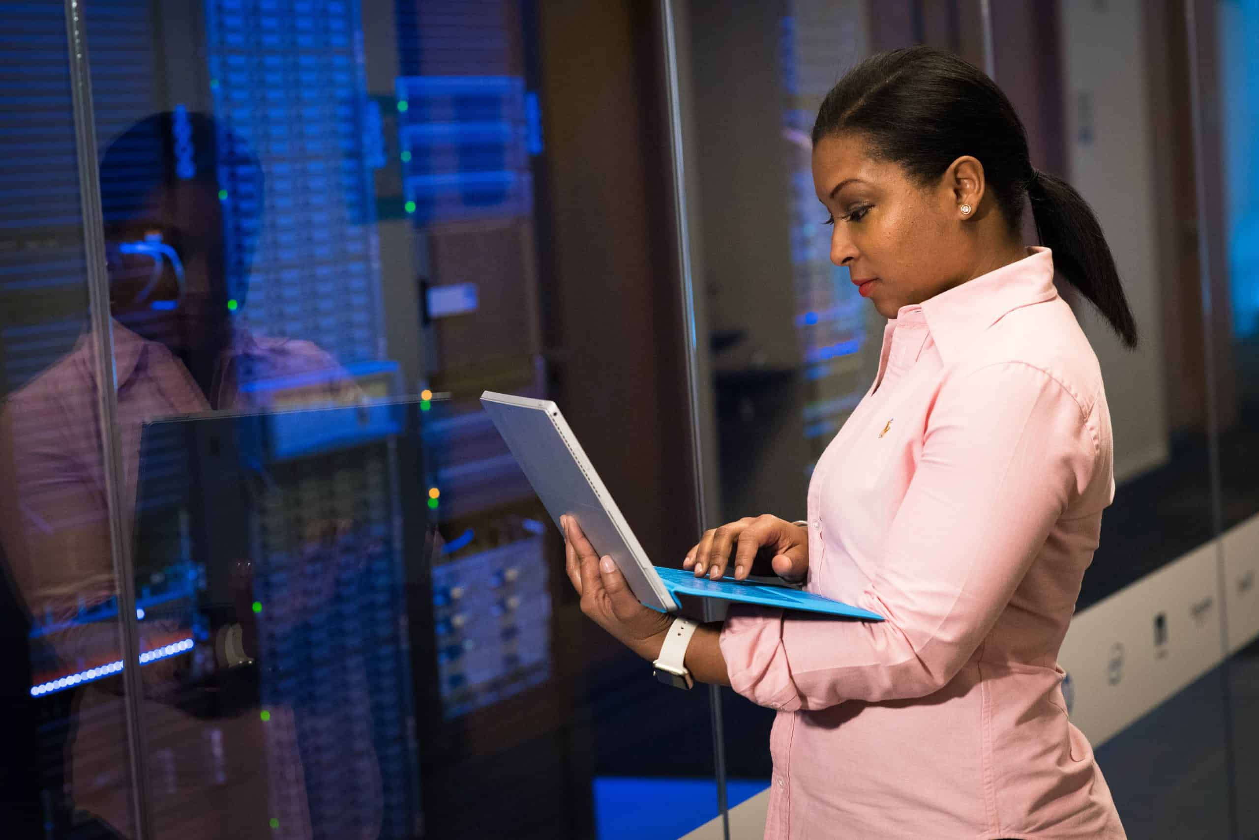 adult african american woman in server room