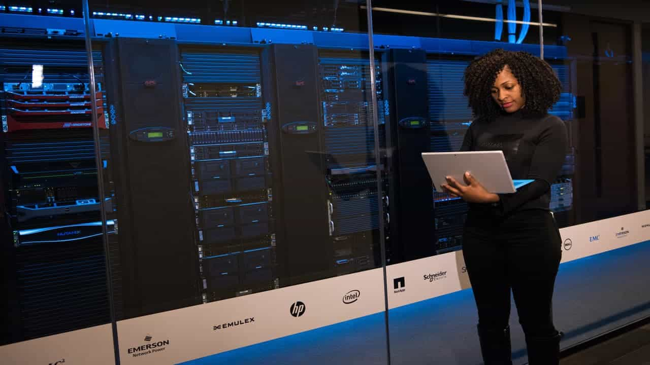 woman with a laptop at some web servers